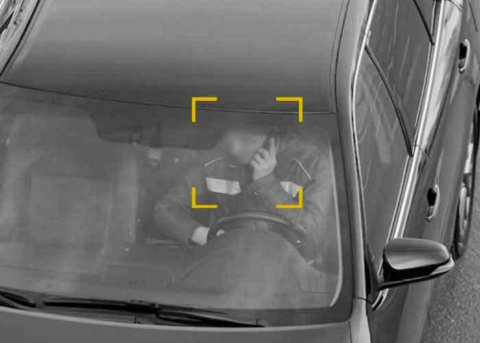 Фотофиксация телефона за рулём